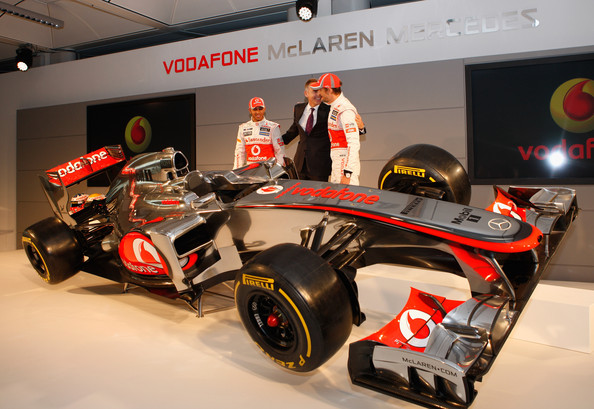 Team McLaren Mercedes drivers Lewis Hamilton (L) and Jenson Button (R) with Mclaren CEO Martin Whitmarsh unveil the new MP-27 Formula 1 car at the McLaren technology centre on February 1, 2012 in Woking, England.