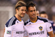 David Beckham of the LA Galaxy poses with Rodrigo Vargas of the Victory after the friendly match between the Melbourne Victory and LA Galaxy at Etihad Stadium on December 6, 2011 in Melbourne, Australia.