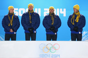 (L-R) Gold medalists Lars Nelson, Daniel Richardsson, Johan Olsson and Marcus Hellner of Sweden take the podium during the medal ceremony for the Cross Country MenÂ's 4 x 10 km Relay on day ten of the Sochi 2014 Winter Olympics at the Medals Plaza on February 17, 2014 in Sochi, Russia.
