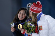 (L-R) Silver medalist Tomoka Takeuchi of Japan, gold medalist Patrizia Kummer of Switzerland and bronze medalist Alena Zavarzina of Russia celebrate on the podium during the medal ceremony for the Women's Parallel Giant Slalom on day twelve of the Sochi 2014 Winter Olympics at at Medals Plaza on February 19, 2014 in Sochi, Russia.