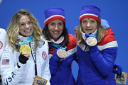 Gold medalist Jessica Diggins of the United States and bronze medalists Marit Bjoergen and Maiken Caspersen Falla of Norway celebrate during the medal ceremony for Cross-Country Skiing - Ladies' Team Sprint Free on day 13 of the PyeongChang 2018 Winter Olympic Games at Medal Plaza on February 22, 2018 in Pyeongchang-gun, South Korea.