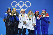 Silver medalists Charlotte Kalla and Stina Nilsson of Sweden, gold medalists Jessica Diggins and Kikkan Randall of the United States and bronze medalists Maiken Caspersen Falla and Marit Bjoergen of Norway celebrate during the medal ceremony for Cross-Country Skiing - Ladies' Team Sprint Free on day 13 of the PyeongChang 2018 Winter Olympic Games at Medal Plaza on February 22, 2018 in Pyeongchang-gun, South Korea.
