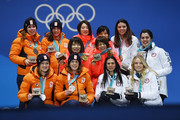 Silver medalists Marrit Leenstra, Lotte Van Beek, Ireen Wust and Antoinette De Jong of the Netherlands, gold medalists Miho Takagi, Ayaka Kikuchi, Ayano Sato and Nana Takagi of Japan and bronze medalists Heather Bergsma, Brittany Bowe, Mia Manganello and Carlijn Schoutens of the United States celebrate during the medal ceremony for Speed Skating - Ladies' Team Pursuit on day 13 of the PyeongChang 2018 Winter Olympic Games at Medal Plaza on February 22, 2018 in Pyeongchang-gun, South Korea.