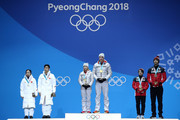 (L-R) Silver medalists Wenjing Sui and Cong Han of China, gold medalists Aljona Savchenko and Bruno Massot of Germany and bronze medalists Meagan Duhamel and Eric Radford of Canada celebrate during the medal ceremony for the Pair Skating Free Skating on day six of the PyeongChang 2018 Winter Olympic Games at Medal Plaza on February 15, 2018 in Pyeongchang-gun, South Korea.
