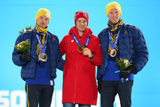 (L-R) Silver medalist Johan Olsson of Sweden, gold medalist Dario Cologna of Switzerland and bronze medalist Daniel Richardsson of Sweden celebrate on the podium during the medal ceremony for the Cross Country Men's 15km Classic event on day 7 of the Sochi 2014 Winter Olympics at Medals Plaza on February 14, 2014 in Sochi, Russia.