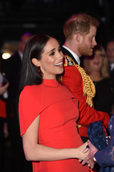 The Duke And Duchess Of Sussex Attend Mountbatten Music Festival [red,event,fashion,fun,party,dance,fashion accessory,harry,meghan,sussex,duchess,england,london,royal albert hall,duke and duchess of sussex attend mountbatten music festival,duke of sussex,mountbatten music festival,celebrity,fashion,hair m,carpet,stx it20 risk.5rv nr eo,dress,formal wear,socialite,long hair,02pd - circolo del partito democratico di milano]