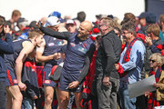 Nathan Jones of the Demons poses for a photo with supporters in the crowd during a Melbourne Demons AFL training session at Gosch's Paddock on September 19, 2018 in Melbourne, Australia.