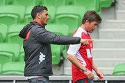 Heart coach John Aloisi directs Harry Kewell of the Heart during a Melbourne Heart A-League media session at AAMI Park on August 20, 2013 in Melbourne, Australia.