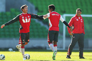 Harry Kewell (L) of the Heart stretches as Heart coach John Aloisi (R) looks on during a Melbourne Heart A-League training session at AAMI Park on July 3, 2013 in Melbourne, Australia.