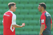 Heart head coach John Aloisi speaks with Harry Kewell during a Melbourne Heart A-League training session at AAMI Park on December 20, 2013 in Melbourne, Australia.