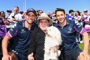 Cameron Smith and Billy Slater of the Storm pose for a photo with Molly Meldrum during the Melbourne Storm Fan Day at Gosch's Paddock on October 1, 2018 in Melbourne, Australia.