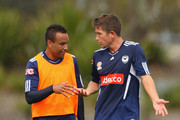 Archie Thompson of the Victory talks with Harry Kewell during a Melbourne Victory A-League training session at Gosch's Paddock on September 15, 2011 in Melbourne, Australia.