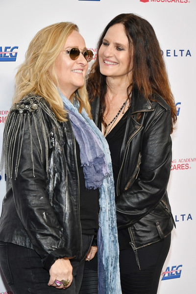 2020 Musicares Person Of The Year Honoring Aerosmith - Arrivals [musicares person of the year,eyewear,sunglasses,leather,leather jacket,jacket,outerwear,event,premiere,vision care,textile,arrivals,linda wallem,melissa etheridge,l-r,los angeles convention center,west hall,california,aerosmith,linda wallem,melissa etheridge,musicares person of the year,musicares,celebrity,aerosmith,grammy awards,actor]