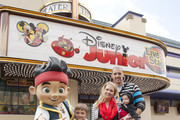 """In this handout photo provided by Disney Parks, Actress Melissa Joan Hart, musician/husband Mark Wilkerson and children, (L-R) Mason Wilkerson, Braydon Wilkerson and Tucker Wilkerson pose with Jake of """"Jake and The Never Land Pirates""""at Disney Junior: Live On Stage! inside of Disney?s California Adventure Park on March 9, 2013 in Anaheim, California."""