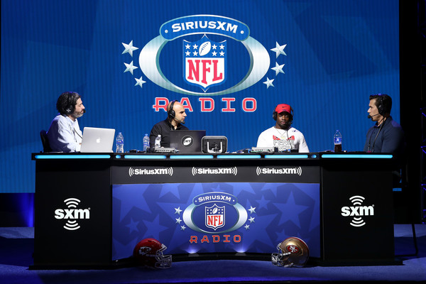 SiriusXM At Super Bowl LIV - Day 2 [event,display device,stage equipment,company,bruce murray,bruce gradkowski,brady quinn,running back,melvin gordon,l-r,siriusxm,nfl,los angeles chargers,super bowl,ed mccaffrey,solomon wilcots,bruce murray,juju smith-schuster,nfl,super bowl,new york giants,pittsburgh steelers,american football,running back]