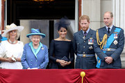 (L-R)  Camilla, Duchess of Cornwall, Queen Elizabeth II, Meghan, Duchess of Sussex, Prince Harry, Duke of Sussex and Prince William, Duke of Cambridge watch the RAF flypast on the balcony of Buckingham Palace, as members of the Royal Family attend events to mark the centenary of the RAF on July 10, 2018 in London, England.
