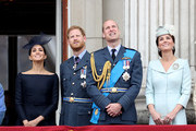 (L-R) Meghan, Duchess of Sussex, Prince Harry, Duke of Sussex, Prince William, Duke of Cambridge and Catherine, Duchess of Cambridge watch the RAF flypast on the balcony of Buckingham Palace, as members of the Royal Family attend events to mark the centenary of the RAF on July 10, 2018 in London, England.