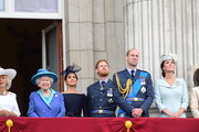 Camilla, Duchess of Cornwall, Queen Elizabeth II, Meghan, Duchess of Sussex, Prince Harry, Duke of Sussex, Prince William Duke of Cambridge and Catherine, Duchess of Cambridge watch the RAF 100th anniversary flypast from the balcony of Buckingham Palace on July 10, 2018 in London, England.