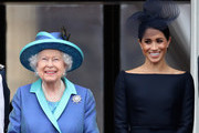 Queen Elizabeth II and Meghan, Duchess of Sussex watch the RAF flypast on the balcony of Buckingham Palace, as members of the Royal Family attend events to mark the centenary of the RAF on July 10, 2018 in London, England.