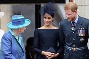 (L-R)  Queen Elizabeth II, Meghan, Duchess of Sussex, Prince Harry, Duke of Sussex watch the RAF flypast on the balcony of Buckingham Palace, as members of the Royal Family attend events to mark the centenary of the RAF on July 10, 2018 in London, England.