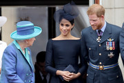 (L-R)  Queen Elizabeth II, Meghan, Duchess of Sussex and Prince Harry, Duke of Sussex watch the RAF flypast on the balcony of Buckingham Palace, as members of the Royal Family attend events to mark the centenary of the RAF on July 10, 2018 in London, England.