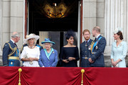 (L-R)  Prince Charles, Prince of Wales, Camilla, Duchess of Cornwall, Queen Elizabeth II, Meghan, Duchess of Sussex, Prince Harry, Duke of Sussex, Prince William, Duke of Cambridge and Catherine, Duchess of Cambridge watch the RAF flypast on the balcony of Buckingham Palace, as members of the Royal Family attend events to mark the centenary of the RAF on July 10, 2018 in London, England.
