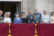 (L-R)  Prince Charles, Prince of Wales, Camilla, Duchess of Cornwall,  Queen Elizabeth II, Meghan, Duchess of Sussex, Prince Harry, Duke of Sussex, Prince William, Duke of Cambridge, Catherine, Duchess of Cambridge and Princess Anne, Princess Royal watch the RAF flypast on the balcony of Buckingham Palace, as members of the Royal Family attend events to mark the centenary of the RAF on July 10, 2018 in London, England.