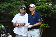Justin Rose of England speaks with his caddie, Mark Fulcher, looks on during the first round of The Memorial Tournament Presented by Nationwide at Muirfield Village Golf Club on May 31, 2018 in Dublin, Ohio.
