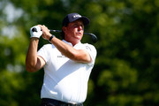 Phil Mickelson plays a shot on the first hole during the final round of the Memorial Tournament presented by Nationwide Insurance at Muirfield Village Golf Club on June 1, 2014 in Dublin, Ohio.