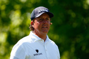 Phil Mickelson watches his  shot on the 4th hole during the final round of the Memorial Tournament presented by Nationwide Insurance at Muirfield Village Golf Club on June 1, 2014 in Dublin, Ohio.