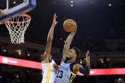 Ben McLemore #23 of the Memphis Grizzlies goes up for a dunk against Kevin Durant #35 of the Golden State Warriors  at ORACLE Arena on December 20, 2017 in Oakland, California. NOTE TO USER: User expressly acknowledges and agrees that, by downloading and or using this photograph, User is consenting to the terms and conditions of the Getty Images License Agreement.