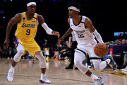 Ja Morant #12 of the Memphis Grizzlies drives to the basket on Rajon Rondo #9 of the Los Angeles Lakers during the third quarter at Staples Center on February 21, 2020 in Los Angeles, California.  NOTE TO USER: User expressly acknowledges and agrees that, by downloading and or using this photograph, User is consenting to the terms and conditions of the Getty Images License Agreement.
