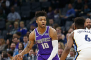 Frank Mason III #10 of the Sacramento Kings is guarded by Mario Chalmers #6 of the Memphis Grizzlies at Golden 1 Center on December 31, 2017 in Sacramento, California. NOTE TO USER: User expressly acknowledges and agrees that, by downloading and or using this photograph, User is consenting to the terms and conditions of the Getty Images License Agreement.