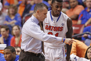 Head coach Billy Donovan talks to Casey Prather #24 of the Florida Gators during second half action against the Fresno State Bulldogs during the MetroPCS Orange Bowl Basketball Classic on December 21, 2013 at the BB&T Center in Sunrise, Florida. Florida defeated Fresno State 66-49.