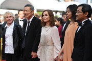 "(L-R) Claire Denis, director Hong SangSoo, Isabelle Huppert, Kim Minheet  and Jeong Jinyoung of  'Claire's Camera (Keul-Le-Eo-Ui-Ka-Me-La)' walk the red carpet ahead of the ""The Meyerowitz Stories"" screening during the 70th annual Cannes Film Festival at Palais des Festivals on May 21, 2017 in Cannes, France."