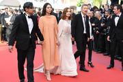 "(L-R) Jeong Jinyoung, Kim Minheet, Isabelle Hupert, director Hong SangSoo and Claire Denis of  'Claire's Camera (Keul-Le-Eo-Ui-Ka-Me-La)' walk the red carpet ahead of the ""The Meyerowitz Stories"" screening during the 70th annual Cannes Film Festival at Palais des Festivals on May 21, 2017 in Cannes, France."