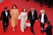 """(L-R) Jeong Jinyoung, Kim Minheet, Isabelle Huppert, director Hong SangSoo and guest of 'Claire's Camera (Keul-Le-Eo-Ui-Ka-Me-La)' attend the """"The Meyerowitz Stories"""" screening during the 70th annual Cannes Film Festival at Palais des Festivals on May 21, 2017 in Cannes, France."""