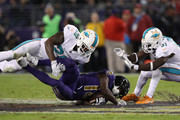 Wide Receiver Jeremy Maclin #18 of the Baltimore Ravens is tackled by free safety Reshad Jones #20 of the Miami Dolphins in the second quarter at M&T Bank Stadium on October 26, 2017 in Baltimore, Maryland.