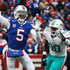 Tyrod Taylor Charles Harris Photos - Tyrod Taylor #5 of the Buffalo Bills throws the ball as Charles Harris #90 of the Miami Dolphins attempts to defend him during the first quarter on December 17, 2017 at New Era Field in Orchard Park, New York. - Miami Dolphins v Buffalo Bills