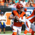 Andy Dalton Photos - Andy Dalton #14 of the Cincinnati Bengals drops back to throw a pass during the first quarter of the game against the Miami Dolphins at Paul Brown Stadium on October 7, 2018 in Cincinnati, Ohio. - Miami Dolphins vs. Cincinnati Bengals