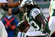 Chris Ivory #33 of the New York Jets carries the ball in the first half against the Miami Dolphins on November 29, 2015 at MetLife Stadium in East Rutherford, New Jersey.