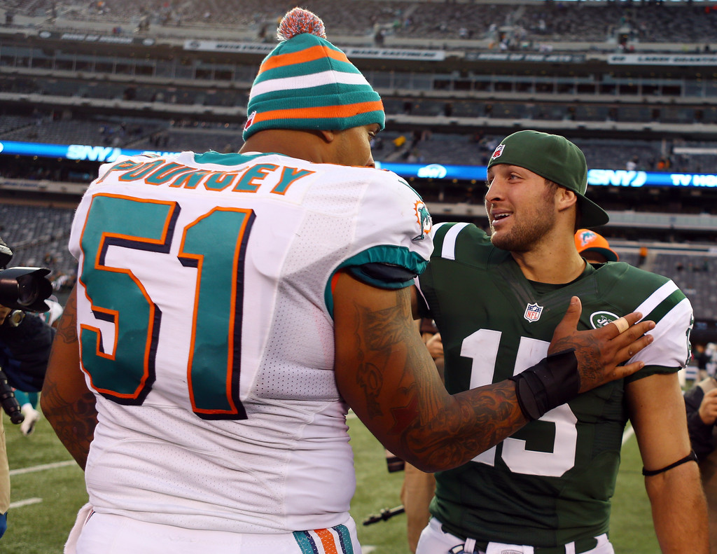 Tim Tebow and Mike Pouncey s s Zimbio