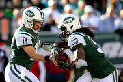 Ryan Fitzpatrick #14 of the New York Jets hands the ball off to Chris Ivory #33 in the first half against the Miami Dolphins on November 29, 2015 at MetLife Stadium in East Rutherford, New Jersey.