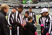 Dante Cano, age 11, presents referee Walt Anderson as commissioner Roger Goodell looks on prior to a game between the New York Jets and the Miami Dolphins at MetLife Stadium on October 28, 2012 in East Rutherford, New Jersey.
