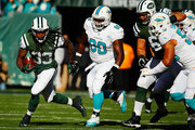 Chris Ivory #33 of the New York Jets runs against  Earl Mitchell #90 of the Miami Dolphins during their game at MetLife Stadium on November 29, 2015 in East Rutherford, New Jersey.