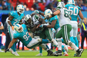 Chris Ivory #33 of the New York Jets is stopped by the Miami Dolphins defense during the game at Wembley Stadium on October 4, 2015 in London, England.