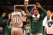 Amir Johnson #90 and Jared Sullinger #7 of the Boston Celtics celebrate in the fourth quater against the Miami Heat at TD Garden on April 13, 2016 in Boston, Massachusetts. NOTE TO USER: User expressly acknowledges and agrees that, by downloading and/or using this photograph, user is consenting to the terms and conditions of the Getty Images License Agreement.