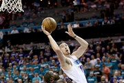 Frank Kaminsky #44 of the Charlotte Hornets shoots over Luol Deng #9 of the Miami Heat during game four of the Eastern Conference Quarterfinals of the 2016 NBA Playoffs at Time Warner Cable Arena on April 25, 2016 in Charlotte, North Carolina.  NOTE TO USER: User expressly acknowledges and agrees that, by downloading and or using this photograph, User is consenting to the terms and conditions of the Getty Images License Agreement.