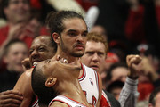 (L-R) Joakim Noah #13, Derrick Rose #1 and Keith Bogans #6 of the Chicago Bulls celebrate late in the fourth quarter against the Miami Heat in Game One of the Eastern Conference Finals during the 2011 NBA Playoffs on May 15, 2011 at the United Center in Chicago, Illinois. The Bulls won 103-82. NOTE TO USER: User expressly acknowledges and agrees that, by downloading and or using this photograph, User is consenting to the terms and conditions of the Getty Images License Agreement