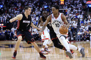 DeMar DeRozan #10 of the Toronto Raptors dribbles the ball as Goran Dragic #7 and Luol Deng #9 of the Miami Heat defend in the second half of Game One of the Eastern Conference Semifinals during the 2016 NBA Playoffs at the Air Canada Centre on May 3, 2016 in Toronto, Ontario, Canada.  NOTE TO USER: User expressly acknowledges and agrees that, by downloading and or using this photograph, User is consenting to the terms and conditions of the Getty Images License Agreement.